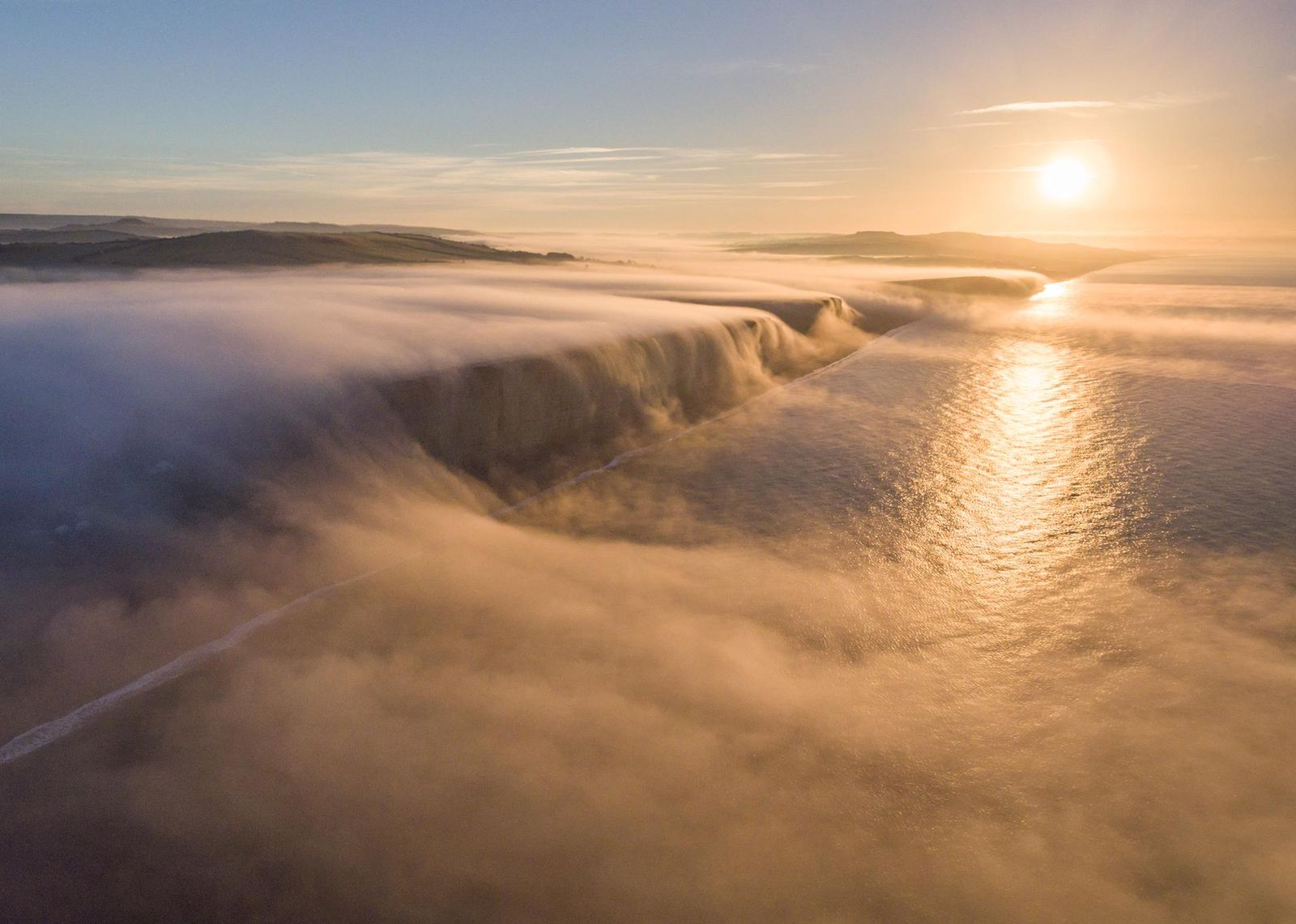A beautiful foggy sunrise on the Dorset Coast
